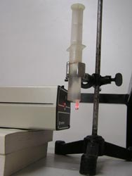 Mikroskop z laseru a kapky vody